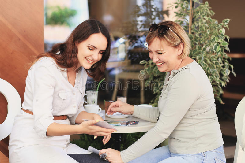 Mom and daughter are in the cafe. stock images