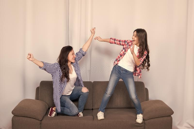 Mom and daughter close friends. Girlish team. Mother and cheerful daughter having fun on couch. Happy childhood. Girls. Having fun. Fun leisure at home. Child stock photos