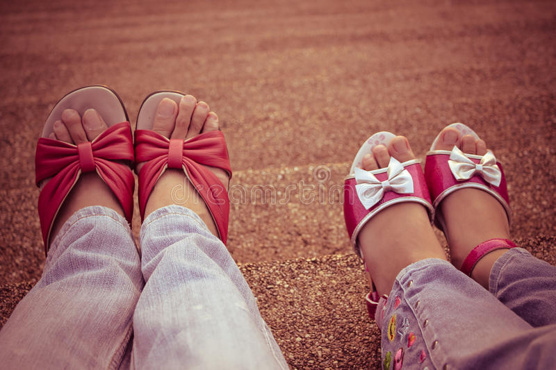 Mother and daughter walking and holding hands in the