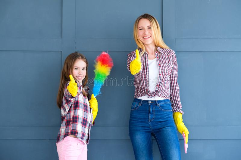 Mom daughter thumbs up clean home household chores. Mom and daughter giving thumbs up to clean home. household and domestic chores concept royalty free stock image