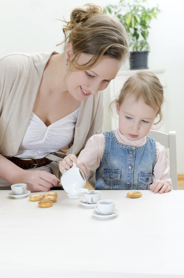Download Mom And Daughter Having Tea Stock Image - Image: 24116691