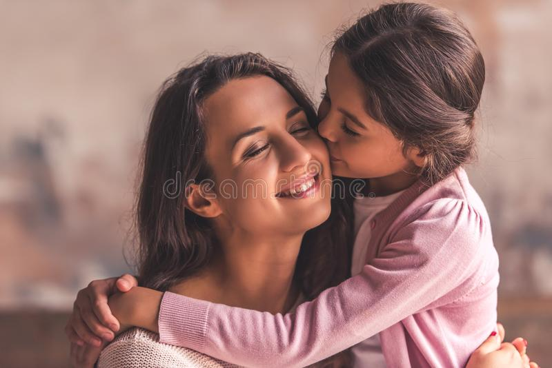 Mom and daughter at home stock photography