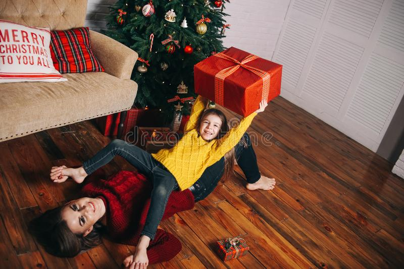 Mom daughter indulge fun inside Christmas decorations stock photography