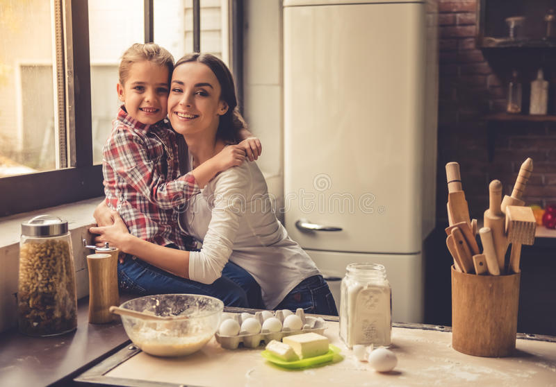 Mom and daughter in kitchen stock image