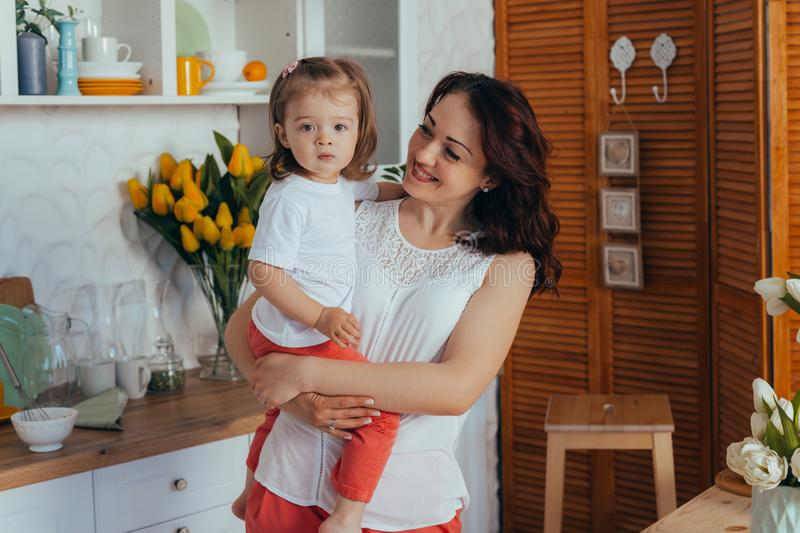 Mom and daughter in the kitchen royalty free stock images
