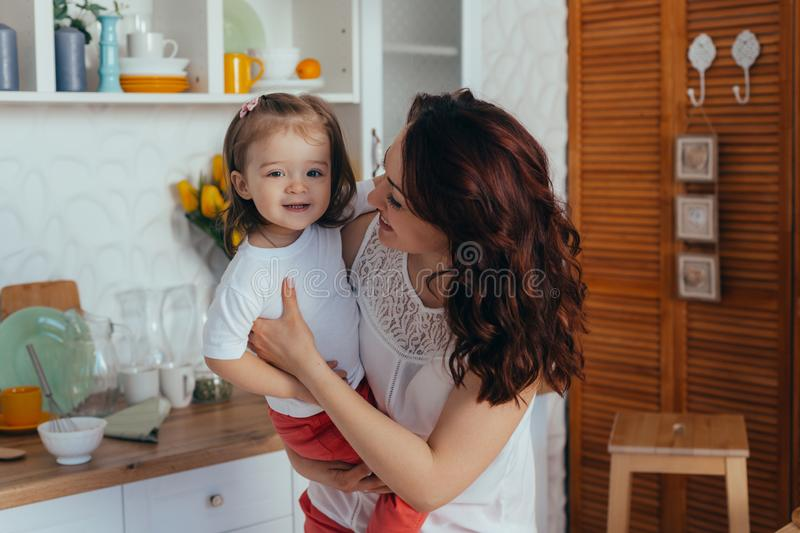 Mom and daughter in the kitchen stock photography