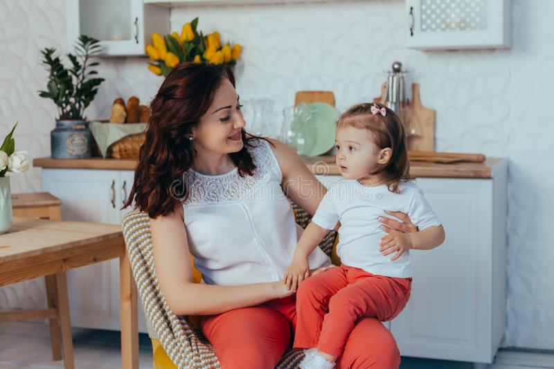 Mom and daughter in the kitchen royalty free stock photos