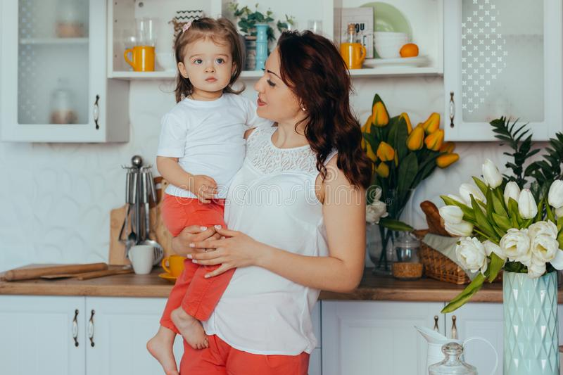 Mom and daughter in the kitchen royalty free stock photography