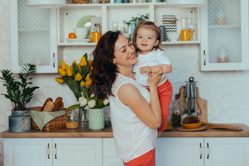Mom and daughter in the kitchen royalty free stock photo