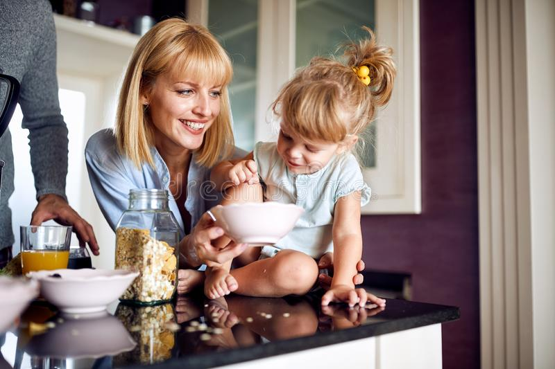 Mom with daughter in the kitchen stock photo