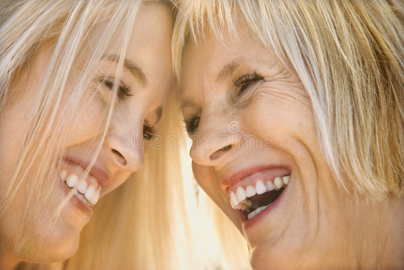 Mom and daughter laughing. stock photos