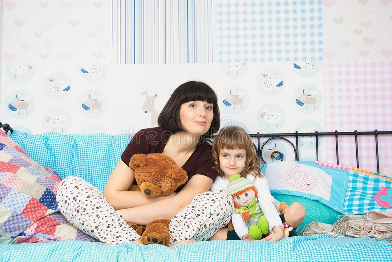Mom And Daughter In Pajamas Royalty Free Stock Photo