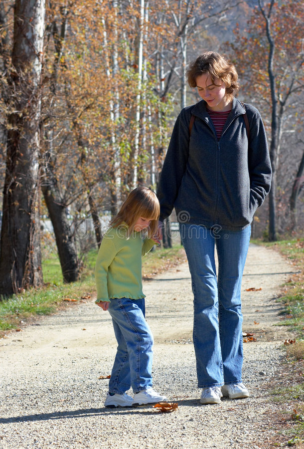 Mom with daughter in the park royalty free stock photo