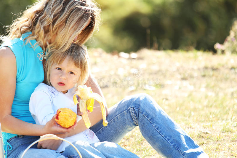 Download Mom and daughter on picnic stock photo. Image of food - 28802780