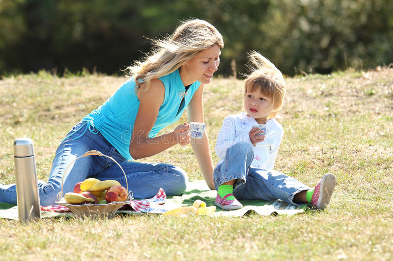 Download Mom and daughter on picnic stock photo. Image of leisure - 28802782