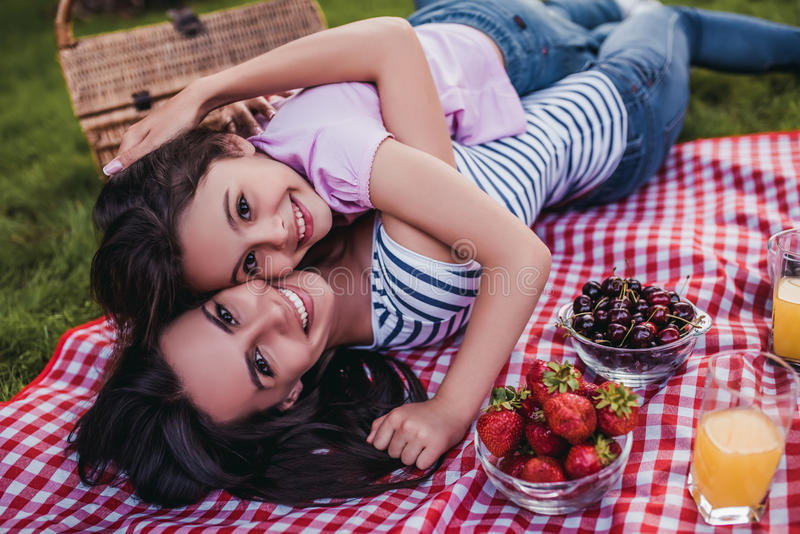 Mom and daughter on picnic royalty free stock photo