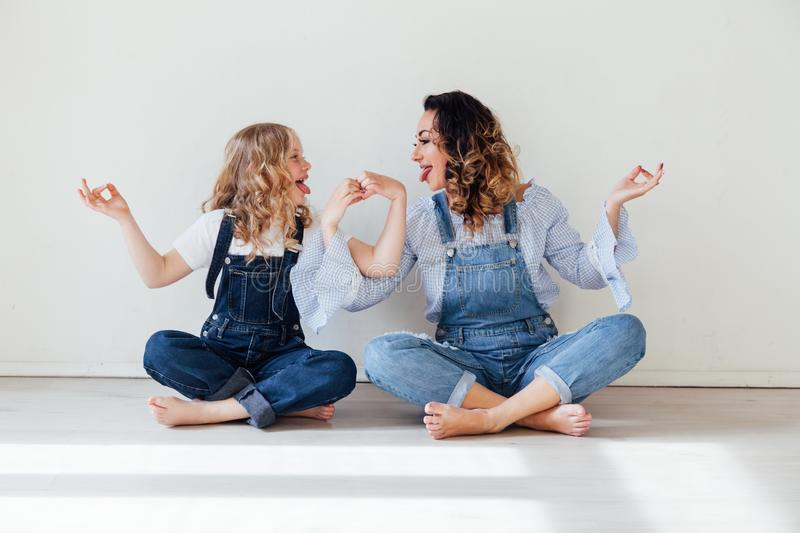 Mom and daughter play show heart with hands. Mom and daughter show heart with hands stock photo