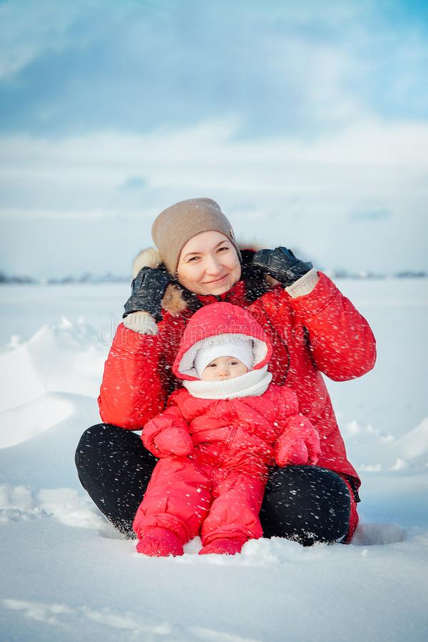 Mom and daughter posing for a winter photo shoot royalty free stock images