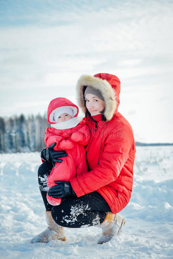 Mom and daughter spend time together for a walk in the cold winter stock photo