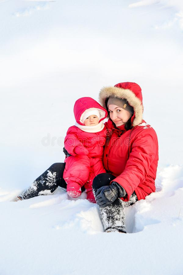 Mom and daughter spend time together for a walk posing snow-covered winter day royalty free stock photography