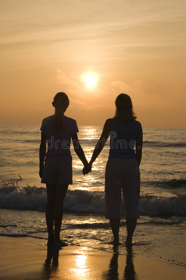 Mom and daughter at sunrise. royalty free stock photo