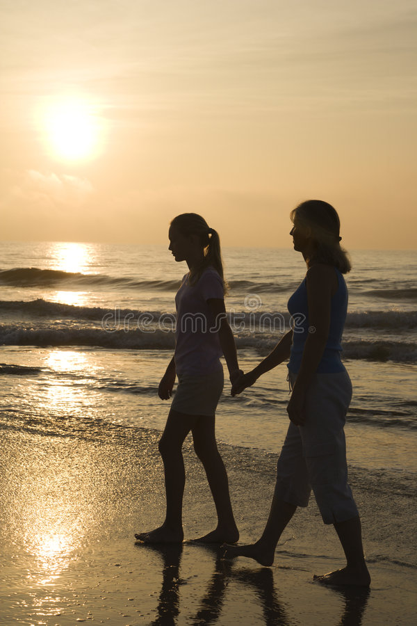 Mom and daughter at sunrise. royalty free stock image