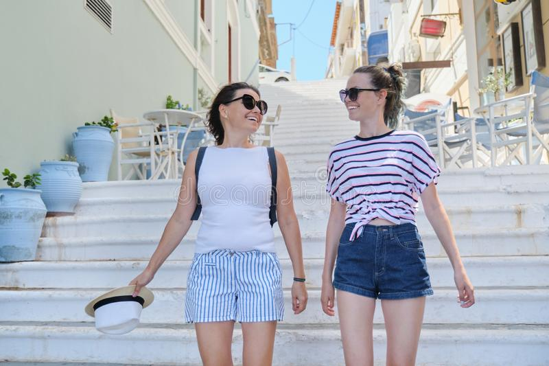 Mom and daughter teenager walking talking together royalty free stock images