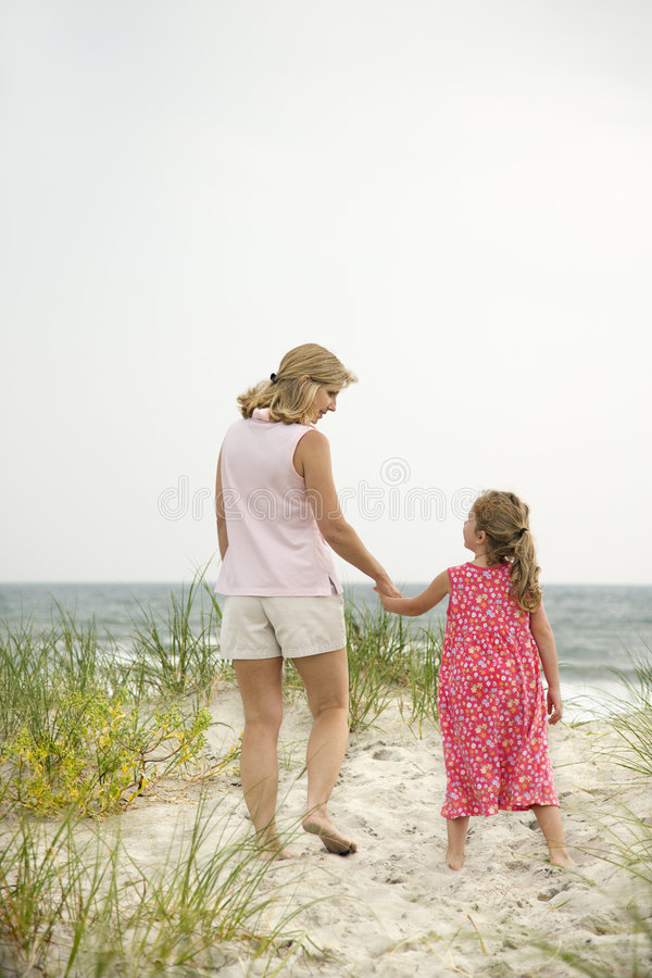 Mom and daughter walking stock photos