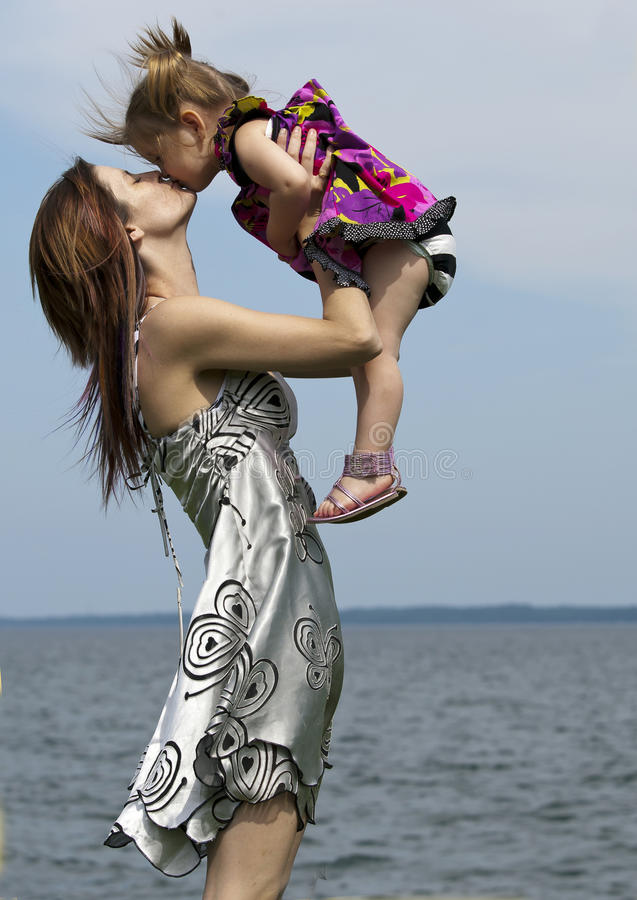 Download Mom And Daughter By The Water Stock Image - Image: 20249077