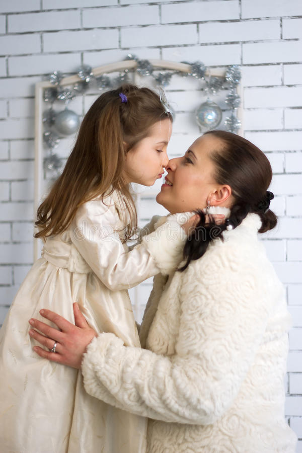 Download Mom And Daughter In The Winter Dresses Stock Photo - Image: 33644178