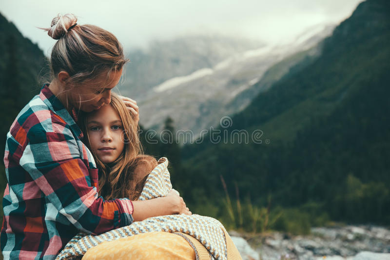 Mom with daughter wrapped in blanket royalty free stock images