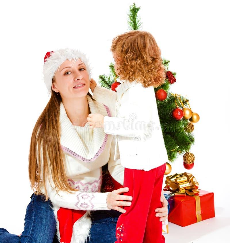mom för juldotterhatt fotografering för bildbyråer