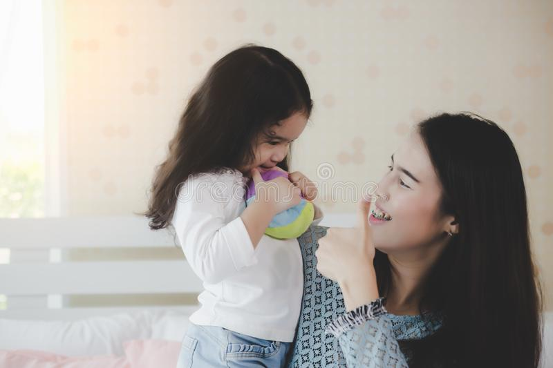 Mom give thumb up to her child or daughter for admiring or like something that her daughter makes terrific, very good or proud of stock photography