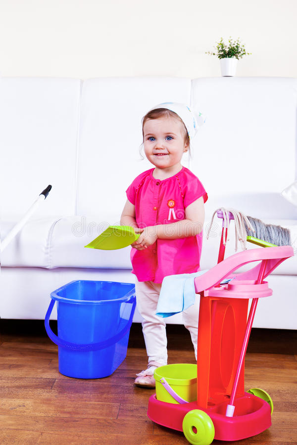 Mom helper. Smiling mom helper cleaning the room royalty free stock photography