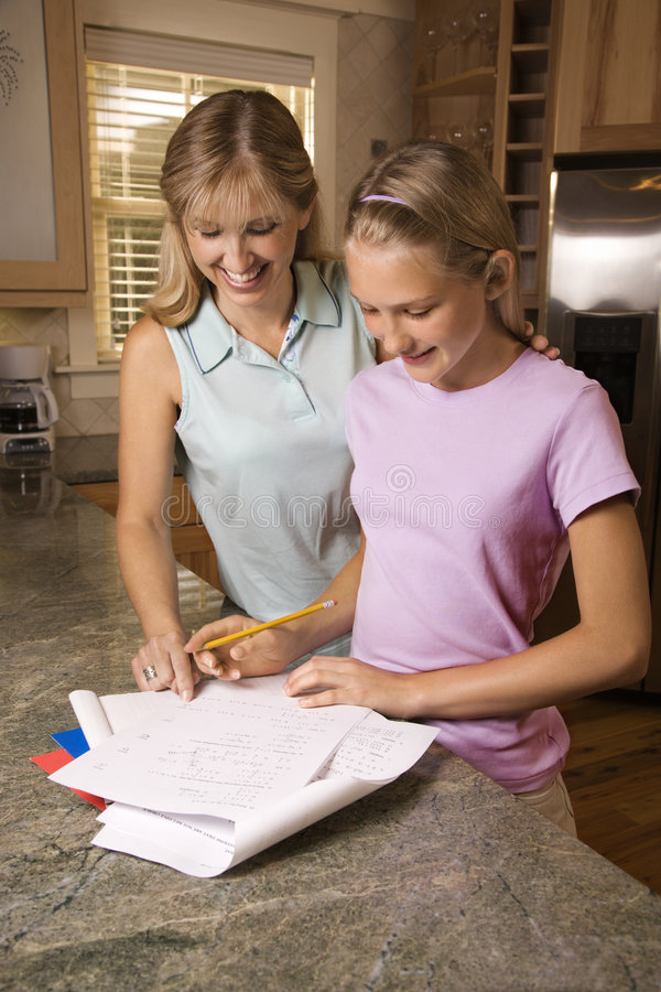 Mom helping daughter with homework. stock photography