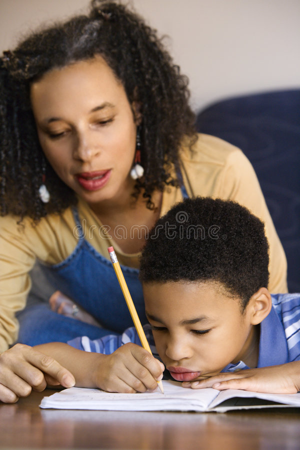 Mom helping son with homework royalty free stock photography