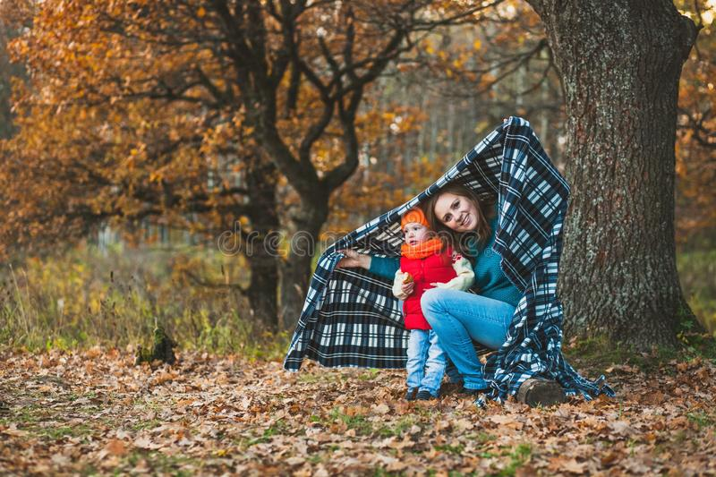 Mom with her daughter in the autumn park royalty free stock photo