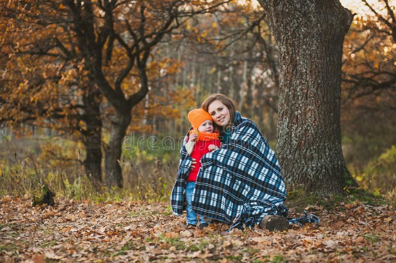 Mom with her daughter in the autumn park royalty free stock images
