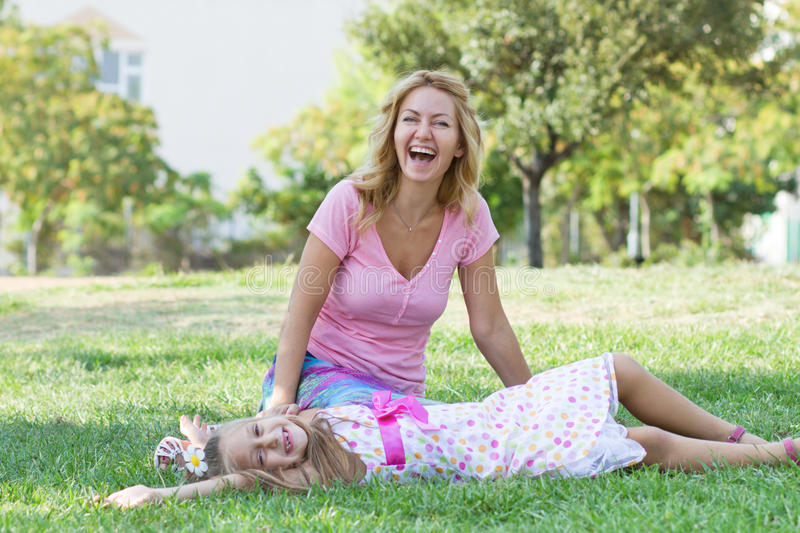 Mom and her daughter in the park royalty free stock photo