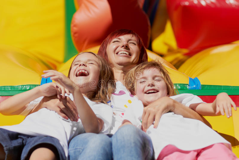 Mom and her daughters having fun stock photo