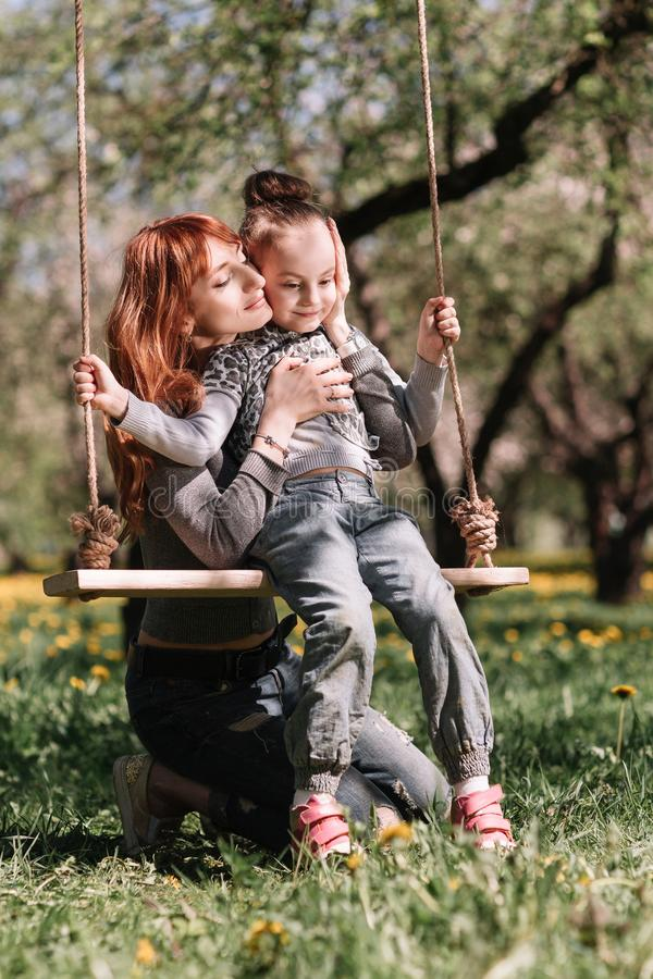 Mom and her little daughter spend their free time together royalty free stock photos