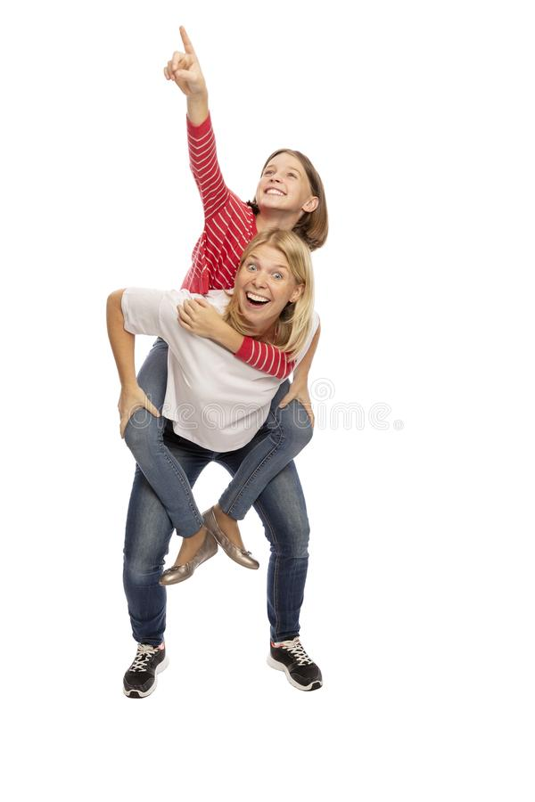 Mom with her teenager daughter hugging and laughing stock photos
