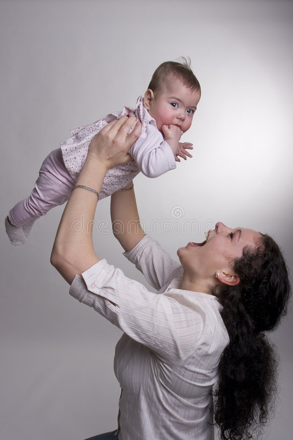 Download Mom Holding Baby Above Her Head Stock Photo - Image: 8128934