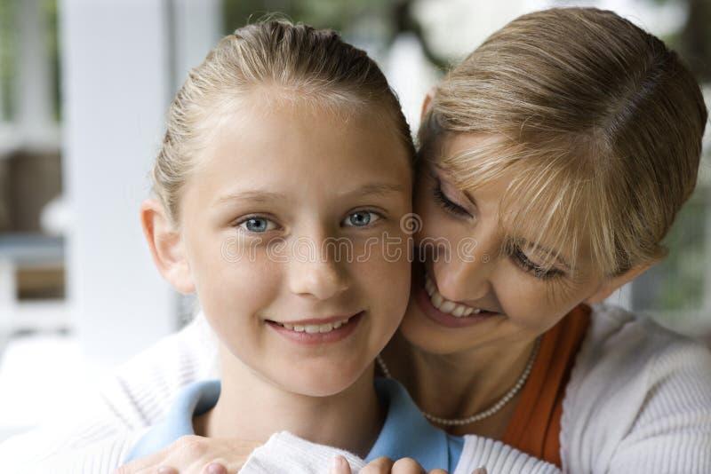 Mom hugging daughter. stock images