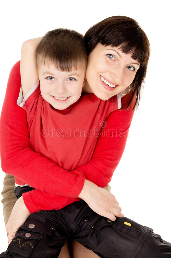 Mom hugging with a small child. Isolated on white background royalty free stock photography