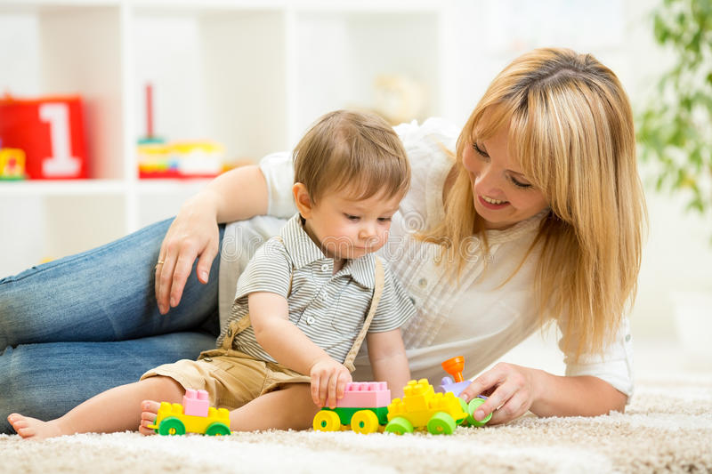 Mom Play Toys : Mom and kid boy playing block toys at home stock photo