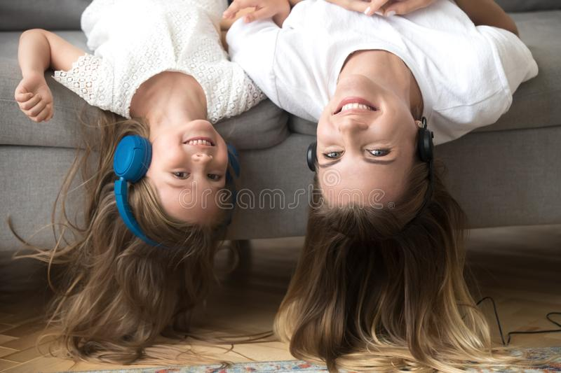 Mom and kid have fun together listening music stock photos