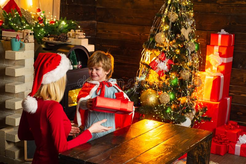 Mom and kid play together christmas eve. Mother and little child boy adorable friendly family having fun. Happy family stock image