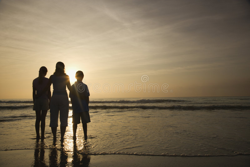 Mom and kids at beach. stock photos