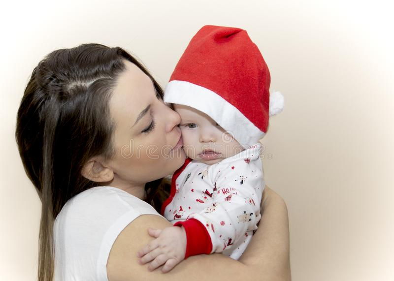 Mom is kissing a little Santa royalty free stock photo